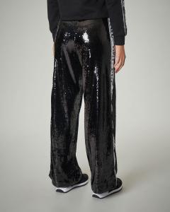 Pantaloni neri in paillettes con logo