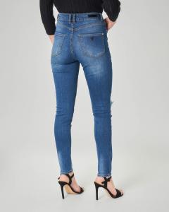 Jeans skinny a vita alta con strappi
