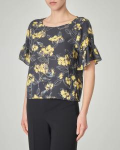 Blusa nera a fantasia floreale gialla con maniche ad aletta con volant