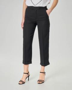 Pantaloni in lino colore nero con risvolto