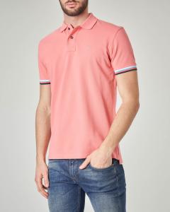 Polo rosa con bordino tricolore sulla manica