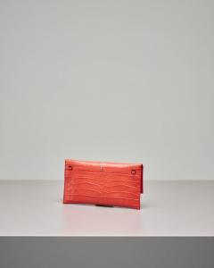 Pochette in pelle color corallo stampa coco con patella e tracolla removibile