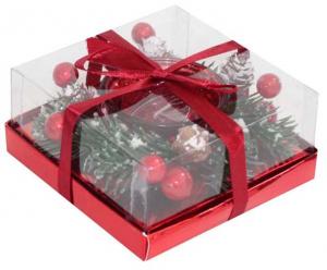 Candela natalizia bicchiere rosso e rametti di pino