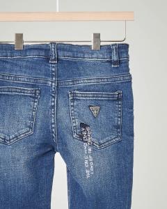 Jeans lavaggio stone wash con scitte 3-7 anni