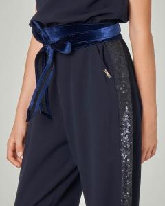 Tuta blu in tessuto elasticizzato con paillettes applicate sul busto 8-14 anni