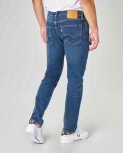 Jeans 502 regular lavaggio blu scuro con baffature