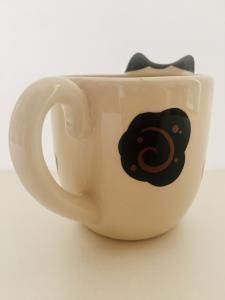 Tazza a forma di gatto bianco e nero