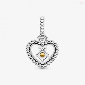 Charm pendente a cuore color miele decorato con sfere