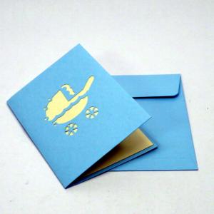 Biglietto piccolo in origamo con culla per auguri nascita