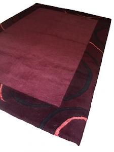 SHAKIRA - 534 - Tappeto arredo tessuto Lana. 142x200. Colore Vinaccia.