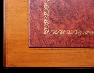 Engraved desk with leather top