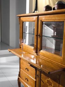 Wooden bar cabinet with display doors