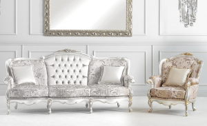 Luxury armchair with golden leaf details