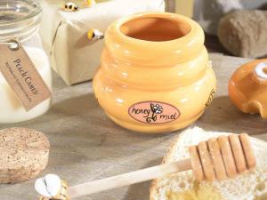 Tre barattoli porta miele in ceramica con cucchiaino di legno