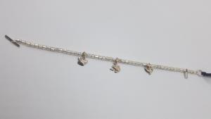 Bracciale DoDo Mariani sampietrini con ciondoli in oro, vendita online | GIOIELLERIA BRUNI Imperia