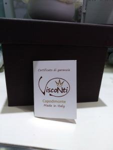 Bomboniera in porcellana Capodimonte Creazioni Visconti Saccottino piccolo N18S