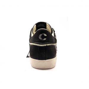 Sneaker nera con borchie Crime London