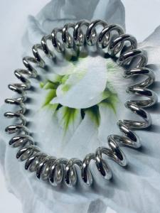Bracciale rigido motivo spirale