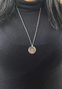 Collana con ciondolo inciso in argento