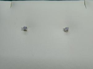 Orecchini Punto luce, griffe Oro bianco 18 kt  con diamante taglio Brillante ct. 0.04