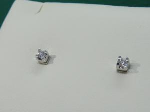 Orecchini Punto luce, griffe Oro bianco 18 kt  con diamante taglio Brillante ct. 0.12