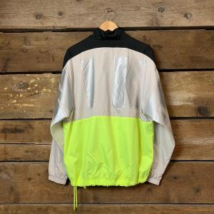 Giacca Nike in Tessuto Woven Nero/Giallo Fluo/Grigio Metallizzato