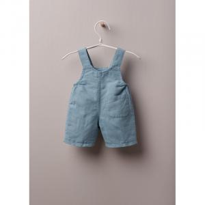 Salopette classica in tessuto leggero di cotone e lino, ottima per neonato e bambina, fino a 4 anni. La salopette BLUE EARTH si allaccia sul davanti con bottoni in madreperla.