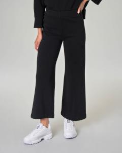 Pantaloni in jersey di cotone nero con fondo ampio