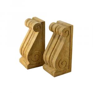 Coppia di reggilibri da ripiano in marmo Giallo Reale scolpito a mano