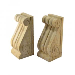 Coppia di reggilibri in marmo Giallo Reale scolpito a mano