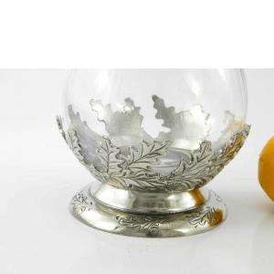 Bottiglia in vetro e peltro con foglie e ghianda