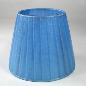 Paralume  Ø12 Ø8 h10 cm tronco conico rivestito da velo organza celeste. Montatura argento a molla.
