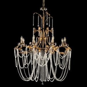 Lampadario a 8 luci con cimiero, allestimento in cristalli molati, struttura bronzo spazzolato oro con foglie e bracci curvi.