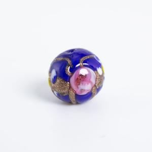 Perla blu vetro Murano tonda Ø16. Fiorata con applicazioni a caldo in avventurina e paste policrome.