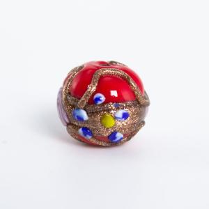 Perla rossa vetro Murano tonda Ø16. Fiorata con applicazioni a caldo in avventurina e paste policrome.