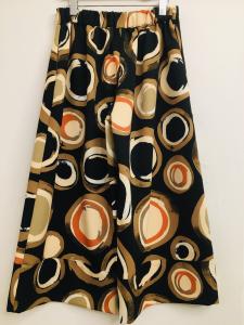 Pantalone donna| fantasia cerchi| in neoprene| taglio svasato| elastico in vita| made in Italy
